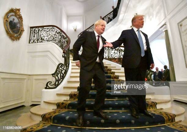 S President Donald Trump and Britain's Prime Minister Boris Johnson arrive for a bilateral meeting during the G7 summit on August 25 2019 in Biarritz...
