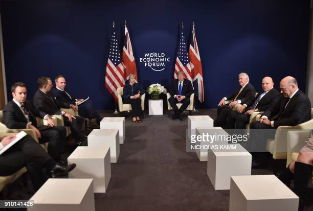 US President Donald Trump and Britain's Prime Minister Theresa May and delegates attend a bilateral meeting on the sidelines of the World Economic...