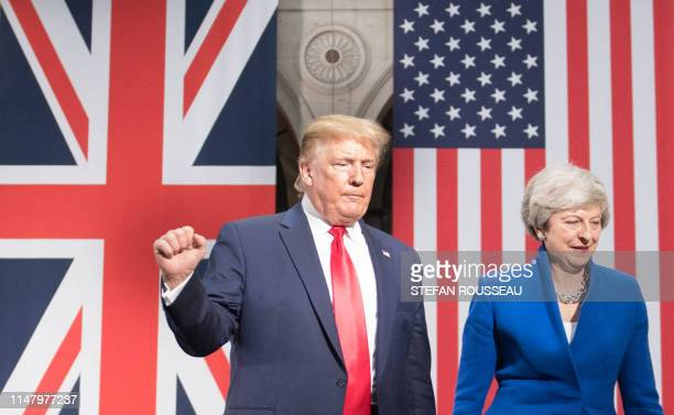 US President Donald Trump and Britain's Prime Minister Theresa May attend a joint press conference at the Foreign and Commonwealth office in London...