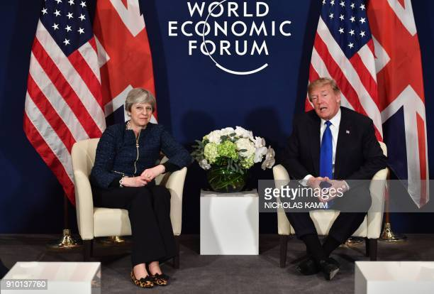 US President Donald Trump and Britain's Prime Minister Theresa May attend a bilateral meeting during the World Economic Forum annual meeting in Davos...