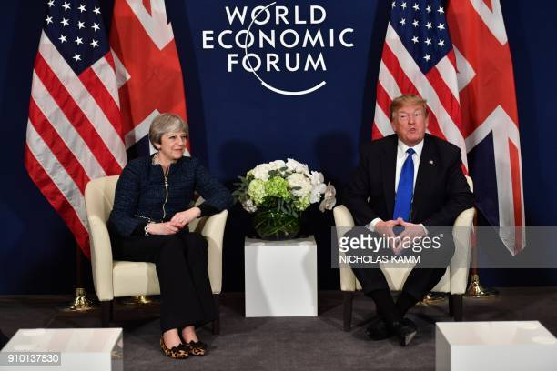 US President Donald Trump and Britain's Prime Minister Theresa May attend a bilateral meeting on the sidelines of the World Economic Forum annual...