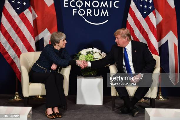 President Donald Trump and Britain's Prime Minister Theresa May shake hands during a bilateral meeting on the sidelines of the World Economic Forum...