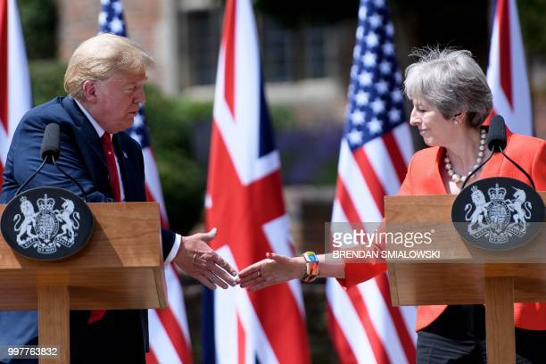 US President Donald Trump and Britain's Prime Minister Theresa May shake hands during a joint press conference following their meeting at Chequers...