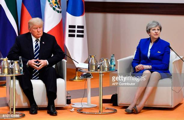 US President Donald Trump and Britain's Prime Minister Theresa May sit at the start of the 'retreat meeting' on the first day of the G20 summit in...