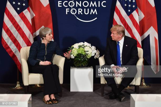 US President Donald Trump and Britain's Prime Minister Theresa May speak during a bilateral meeting on the sidelines of the World Economic Forum...