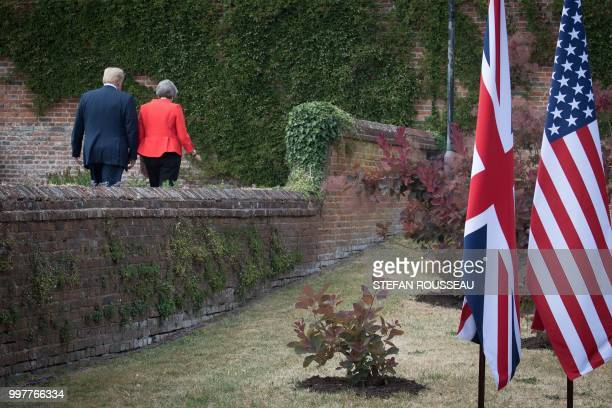 US President Donald Trump and Britain's Prime Minister Theresa May walk together following their joint press conference at Chequers the prime...