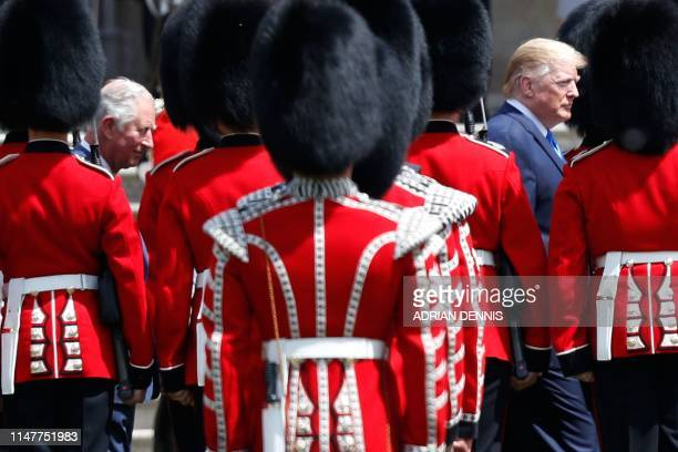 US President Donald Trump and Britain's Prince Charles Prince of Wales inspect the guard of honour during a welcome ceremony at Buckingham Palace in...