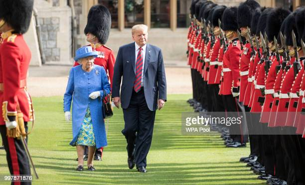 S President Donald Trump and Britain's Queen Elizabeth II inspect a Guard of Honour formed of the Coldstream Guards at Windsor Castle on July 13 2018...