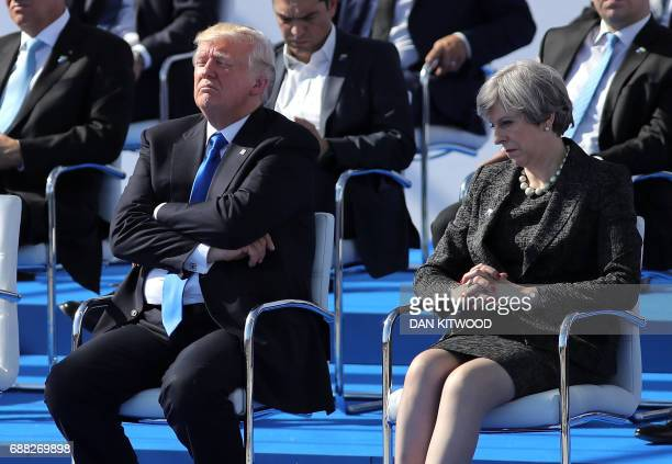 US President Donald Trump and British Prime Minister Theresa May a ceremony at the NATO summit at the NATO headquarters in Brussels on May 25 2017 /...