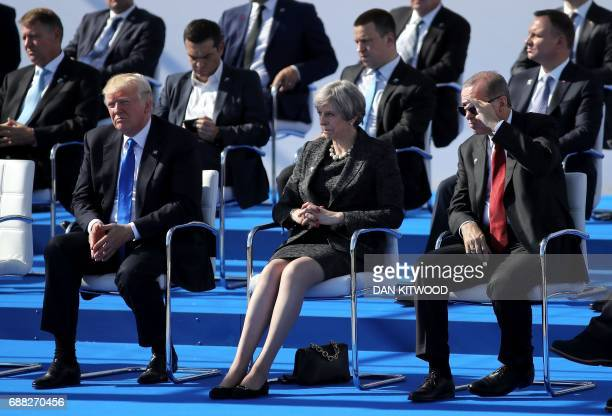 US President Donald Trump and British Prime Minister Theresa May and Turkish President Recep Tayyip Erdogan attend a ceremony at the NATO summit at...
