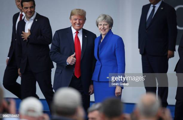 S President Donald Trump and British Prime Minister Theresa May attend the opening ceremony at the 2018 NATO Summit at NATO headquarters on July 11...