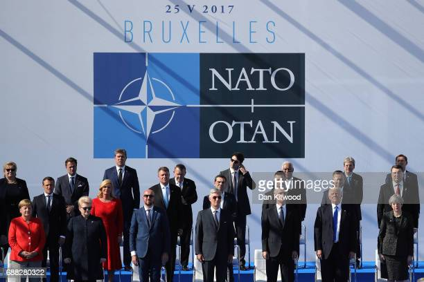 President Donald Trump and British Prime Minister Theresa May during a photo opportunity of leaders as they arrive for a NATO summit meeting on May...