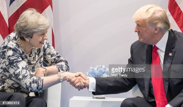 President Donald Trump and British Prime Minister Theresa May hold a bilateral meeting on the second day of the G20 summit on July 8 2017 in Hamburg...