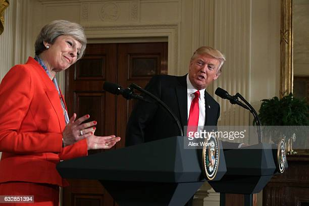 S President Donald Trump and British Prime Minister Theresa May participate in a joint press conference at the East Room of the White House January...