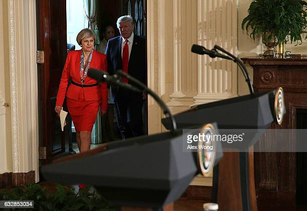 S President Donald Trump and British Prime Minister Theresa May approach the podiums for a joint press conference in the East Room of the White House...