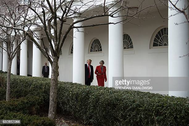 US President Donald Trump and British Prime Minister Theresa May walk to a press conference at the White House on January 27 2017 in Washington DC /...