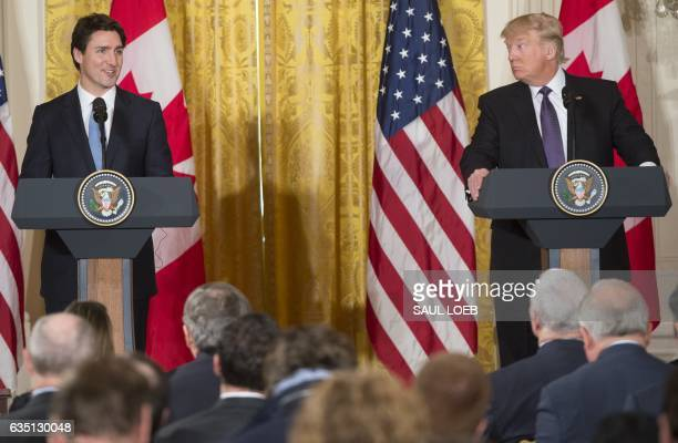 US President Donald Trump and Canadian Prime Minister Justin Trudeau hold a joint press conference in the East Room of the White House in Washington...
