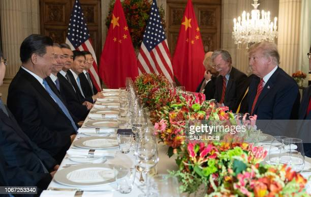 US President Donald Trump and China's President Xi Jinping along with members of their delegations hold a dinner meeting at the end of the G20...