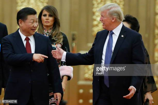 S President Donald Trump and China's President Xi Jinping arrive at a state dinner at the Great Hall of the People on November 9 2017 in Beijing...