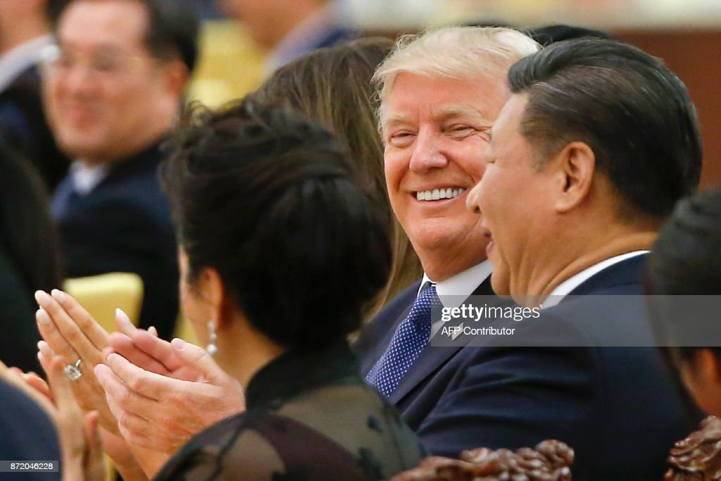US President Donald Trump and China's President Xi Jinping (R) attend a state dinner at the Great Hall of the People in Beijing on November 9, 2017. Donald Trump urged Chinese leader Xi Jinping to work hard and act fast to help resolve the North Korean nuclear crisis during talks in Beijing Thursday, warning that 'time is quickly running out'. /