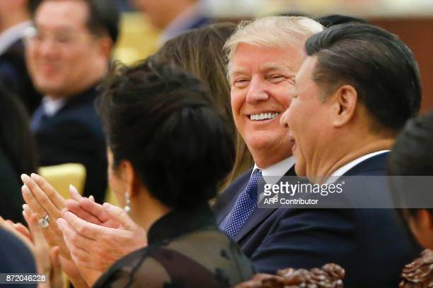 US President Donald Trump and China's President Xi Jinping attend a state dinner at the Great Hall of the People in Beijing on November 9 2017 Donald...