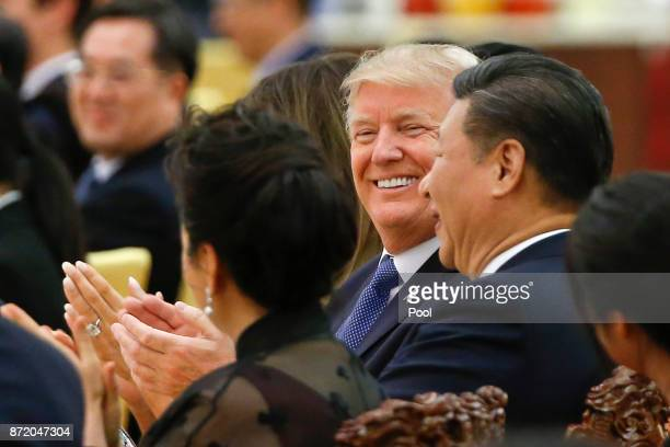 S President Donald Trump and China's President Xi Jinping attend at a state dinner at the Great Hall of the People on November 9 2017 in Beijing...