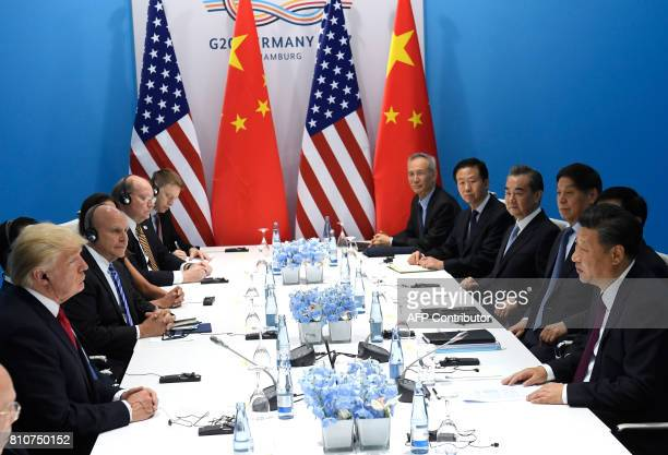 US President Donald Trump and China's President Xi Jinping hold a meeting on the sidelines of the G20 Summit in Hamburg Germany July 8 2017 / AFP...