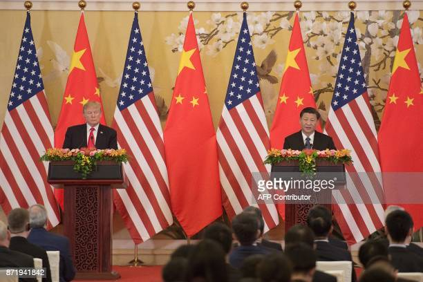 US President Donald Trump and China's President Xi Jinping speak during a joint statement in Beijing on November 9 2017 Donald Trump urged Chinese...