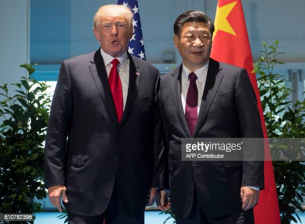 US President Donald Trump and Chinese President Xi Jinping arrive prior to a meeting on the sidelines of the G20 Summit in Hamburg Germany July 8...