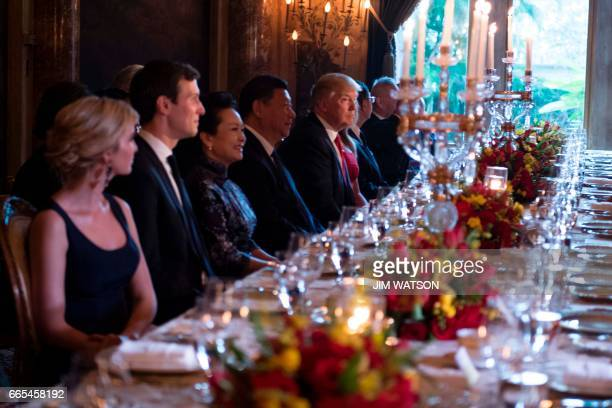 President Donald Trump and Chinese President Xi Jinping look on during dinner at the MaraLago estate in West Palm Beach Florida on April 6 2017 / AFP...