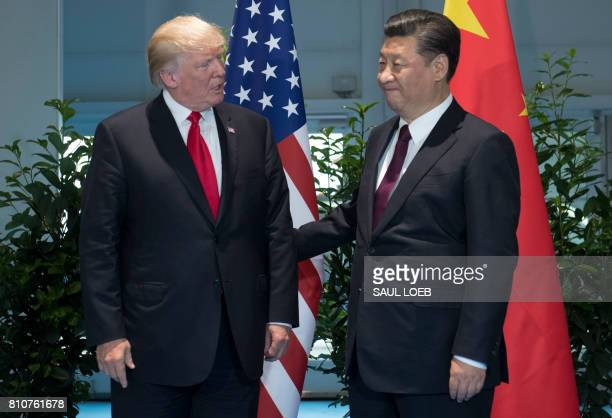 US President Donald Trump and Chinese President Xi Jinping pose prior to a meeting on the sidelines of the G20 Summit in Hamburg Germany July 8 2017