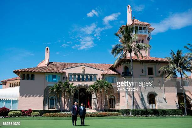 US President Donald Trump and Chinese President Xi Jinping pose together at the MaraLago estate in West Palm Beach Florida April 7 2017 / AFP PHOTO /...