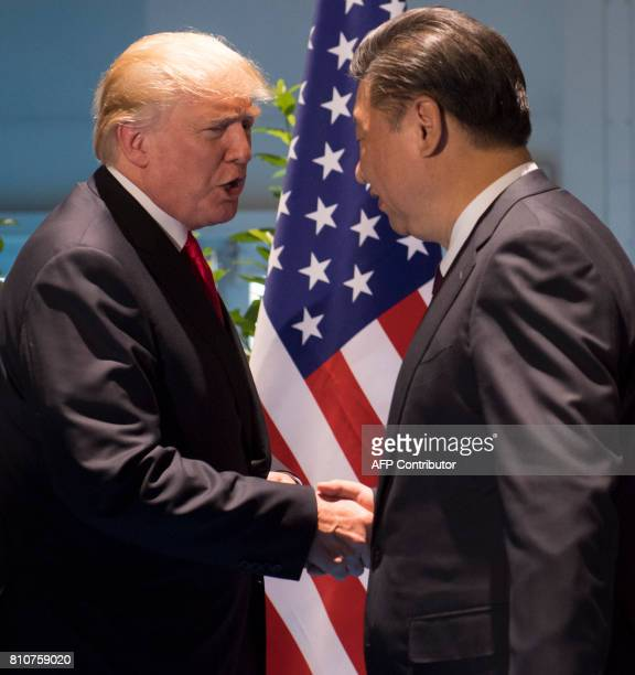 President Donald Trump and Chinese President Xi Jinping shake hands prior to a meeting on the sidelines of the G20 Summit in Hamburg, Germany, July...
