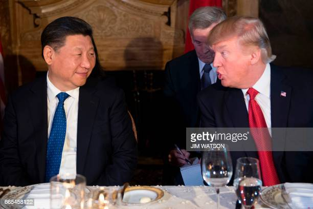 US President Donald Trump and Chinese President Xi Jinping speak during dinner at the MaraLago estate in West Palm Beach Florida on April 6 2017 /...
