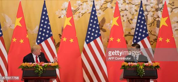 US President Donald Trump and Chinese President Xi Jinping speak during a joint statement in Beijing on November 9 2017 Donald Trump and Xi Jinping...