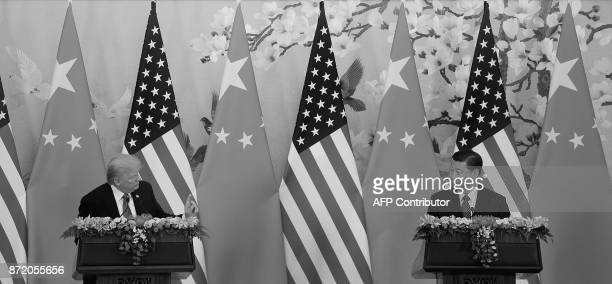 US President Donald Trump and Chinese President Xi Jinping speak during a joint statement at The Great Hall of the People in Beijing on November 9...