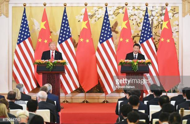 US President Donald Trump and Chinese President Xi Jinping speak to the press following their meeting in Beijing on Nov 9 2017 The two leaders agreed...