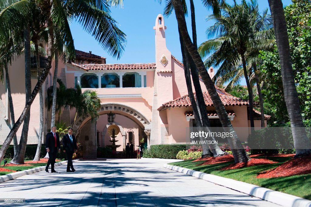 US President Donald Trump (L) and Chinese President Xi Jinping (R) walk together at the Mar-a-Lago estate in West Palm Beach, Florida, April 7, 20 President Donald Trump entered a second day of talks with his Chinese counterpart Xi Jinping on Friday hoping to strike deals on trade and jobs after an overnight show of strength in Syria. /