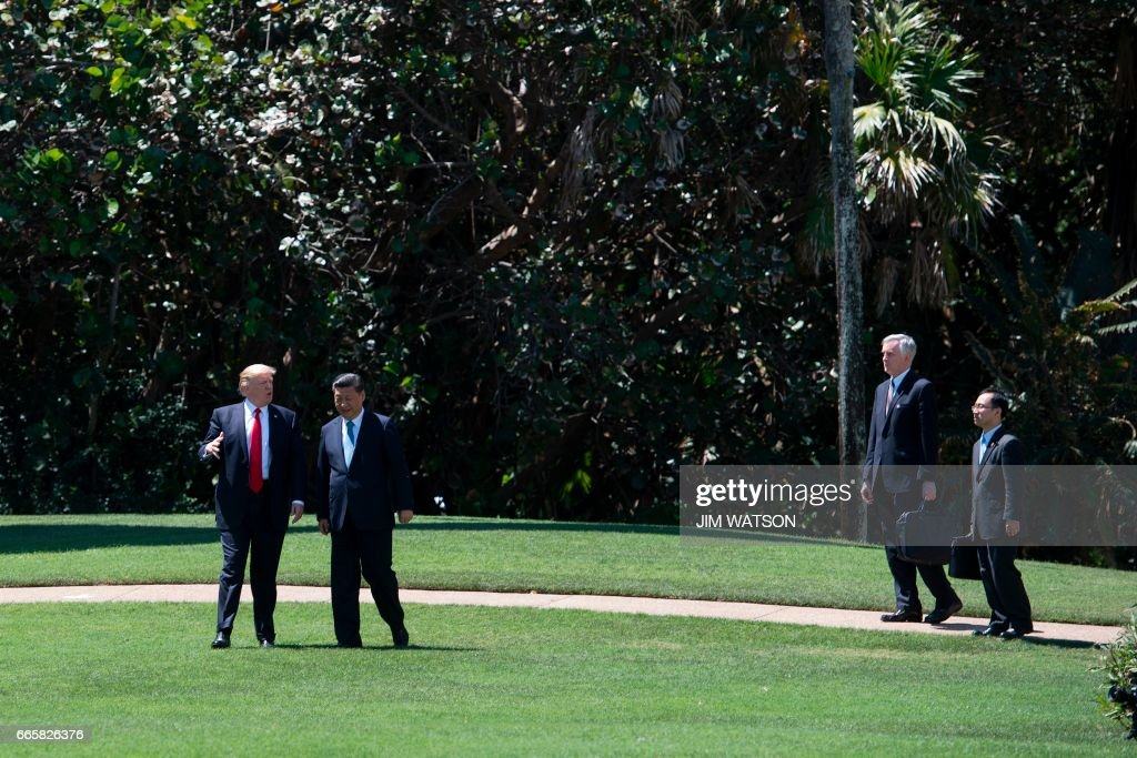 US President Donald Trump (L) and Chinese President Xi Jinping (C) walk together, followed by interpreters at the Mar-a-Lago estate in West Palm Beach, Florida, April 7, 2017. President Donald Trump entered a second day of talks with his Chinese counterpart Xi Jinping on Friday hoping to strike deals on trade and jobs after an overnight show of strength in Syria. /