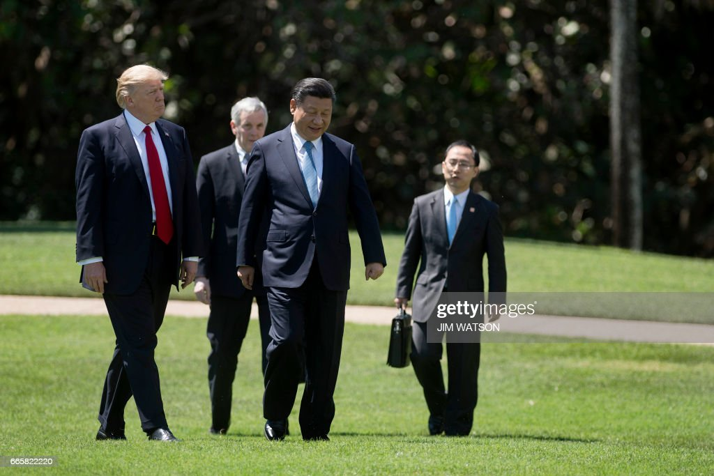US President Donald Trump (L) and Chinese President Xi Jinping (C) walk with their interpreters at the Mar-a-Lago estate in West Palm Beach, Florida, April 7, 2017. President Donald Trump entered a second day of talks with his Chinese counterpart Xi Jinping on Friday hoping to strike deals on trade and jobs after an overnight show of strength in Syria. /