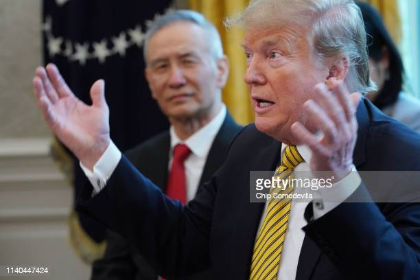 S President Donald Trump and Chinese Vice Premier Liu He talk to reporters in the Oval Office at the White House April 04 2019 in Washington DC The...