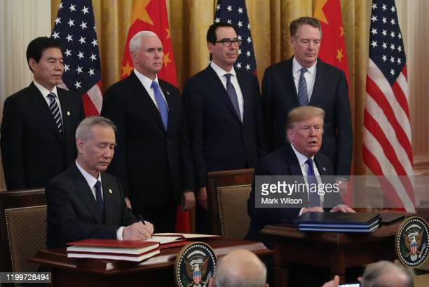 President Donald Trump and Chinese Vice PremierLiuHe sign phase 1 of a trade deal between the U.S. And China, in the East Room at the White House,...
