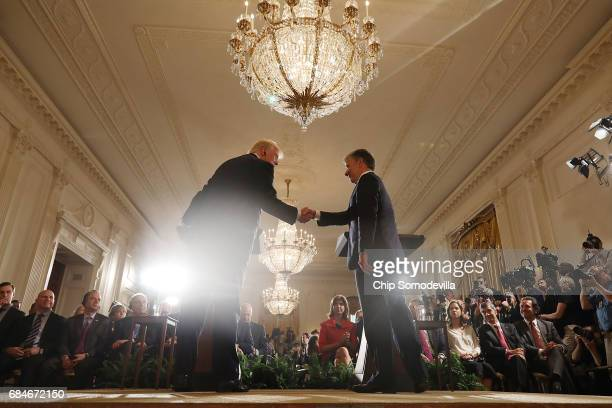 President Donald Trump and Colombian President Juan Manuel Santos shake hands during a joint news conference at the White House May 18, 2017 in...