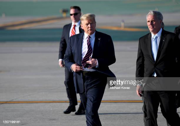 S President Donald Trump and Congressman Kevin McCarthy walk to greet supporters after arriving on Air Force One at LAX Airport on February 18 2020...