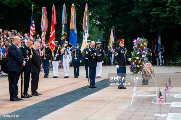 US President Donald Trump and Defense Secretary Jim Mattis mark Memorial Day by laying a wreath at the Tomb of the Unknown Soldier at Arlington...