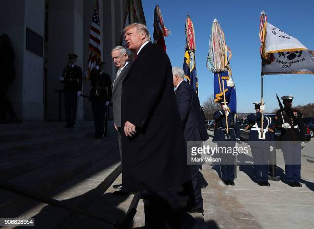 S President Donald Trump and Defense Secretary Jim Mattis walk into the Pentagon for a meeting with military leaders on January 18 2018 in Arlington...