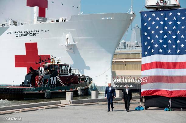 US President Donald Trump and Defense Secretary Mark Esper arrive to speak during the departure ceremony for the hospital ship USNS Comfort at Naval...