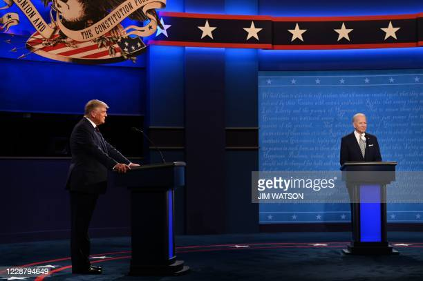 President Donald Trump and Democratic Presidential candidate and former US Vice President Joe Biden are seen during the first presidential debate at...