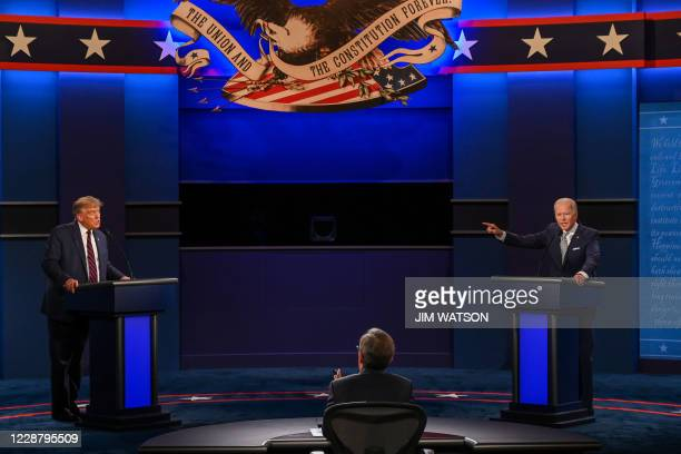 President Donald Trump and Democratic Presidential candidate and former US Vice President Joe Biden exchange arguments during the first presidential...