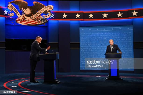 US President Donald Trump and Democratic Presidential candidate and former US Vice President Joe Biden exchange arguments during the first...